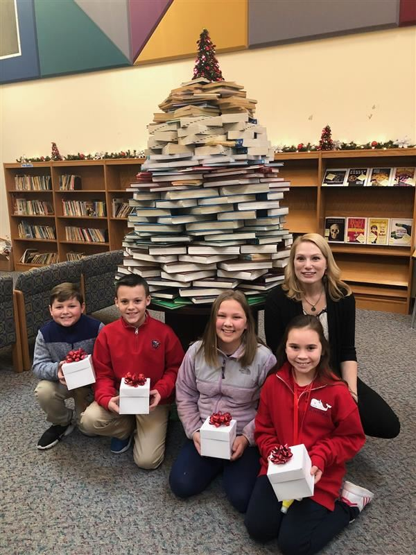 """Holiday Book Tree Created by Miss Voytko in our Library"""