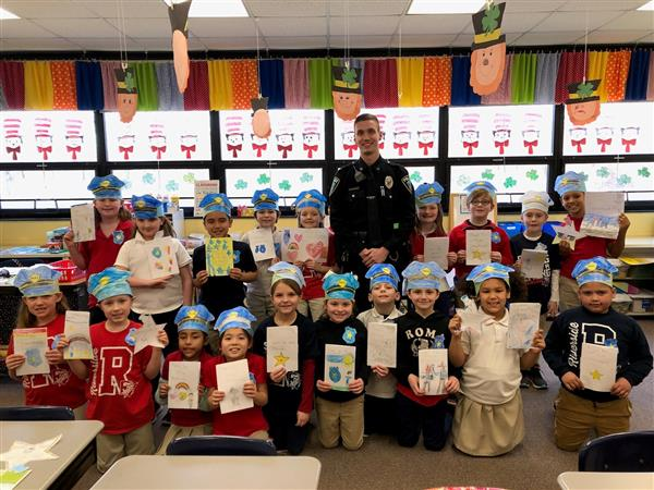 "Ms. Telesz's 2nd Grade Class read ""Officer Buckle and Gloria"", a story about a police officer who visits a school to teach safety tips.  The class decided to make cards for Officer Nick Strenkoski, of the Taylor Police Department."