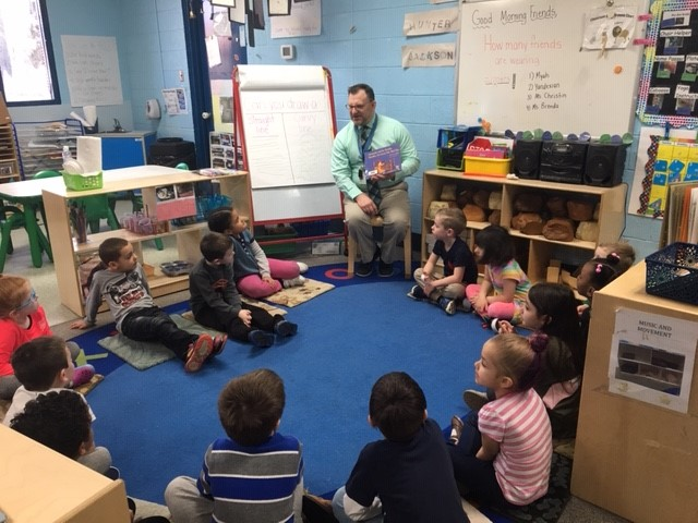 Mr. Pentasuglio reads to the class of 2032 at Taylor Treasure House!